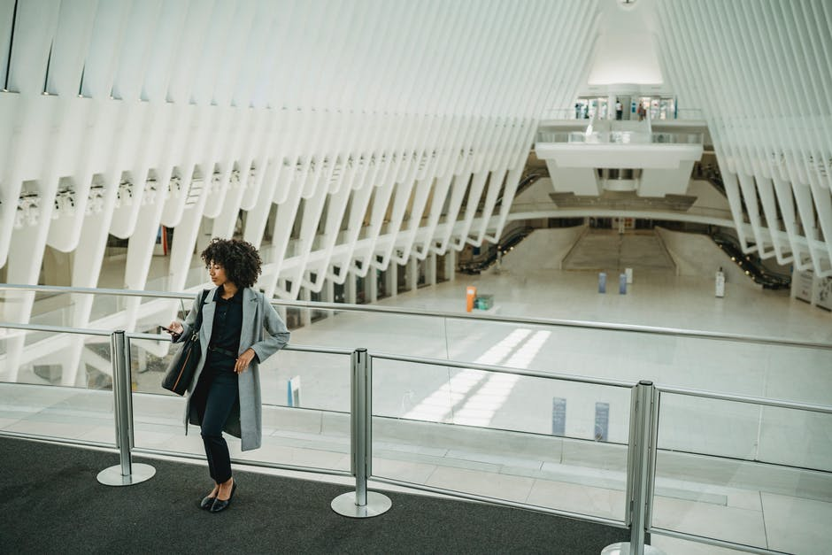 A person standing in front of a plane